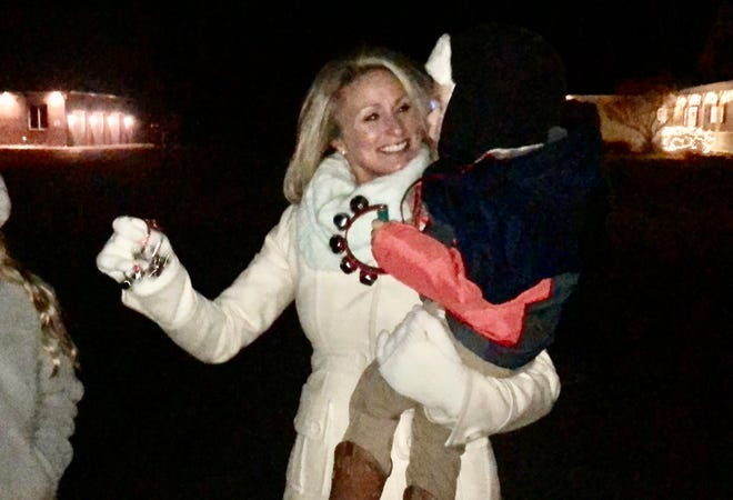 Keri Jones holds her nephew, Rex Rezac, 2, on Dec. 24, 2020, outside their Edwards home. The Rezac family and their neighbors participated in the Christmas Eve Jingle to spread holiday cheer, albeit in a socially distanced way.