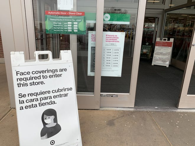 A sign outside of Target reminds shoppers that face coverings are required in Lubbock.