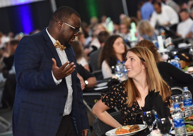 Oberserver-Dispatch sports reporter Marquel Slaughter talks with Remsen's Olympic medalist Erin Hamlin at the All-Mohawk Valley All-Star banquet Tuesday, June 18, 2019 at Mohawk Valley Comminity College in Utica.