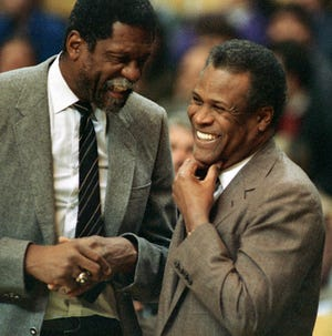 In this Jan. 15, 1988, file photo, former Boston Celtics teammates Bill Russell, Sacramento Kings coach, left, and K.C. Jones, Celtics coach, meet before the start of a game at the Boston Garden.  Jones, who won eight NBA championships as a Celtics player in the 1960s and two more as the coach of the Boston team that took the titles in 1984 and '86, has died. He was 88.