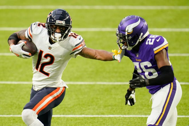 Chicago Bears wide receiver Allen Robinson II (12) runs from Minnesota Vikings cornerback Chris Jones (26) after catching a pass during the second half of an NFL football game, Sunday, Dec. 20, 2020, in Minneapolis.