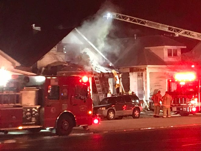 Evansville Firefighters battle a blaze at a home on the West Side Christmas Eve night.