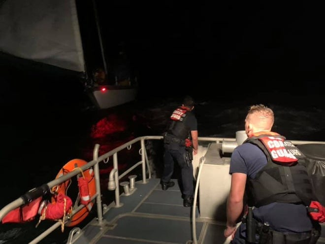 A boat crew from the Coast Guard Station off Fort Myers Beach rescued two people from a disabled sailboat about 23 miles offshore Friday.
