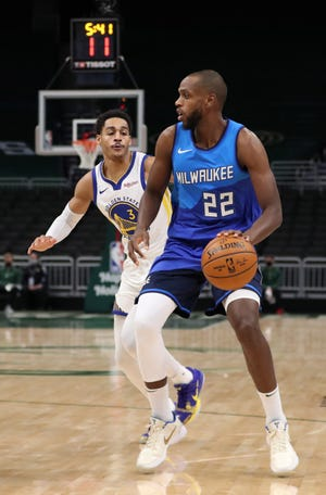 Golden State guard Jordan Poole, trailing Bucks forward Khris Middleton, played the first NBA game in his hometown on Christmas Day.