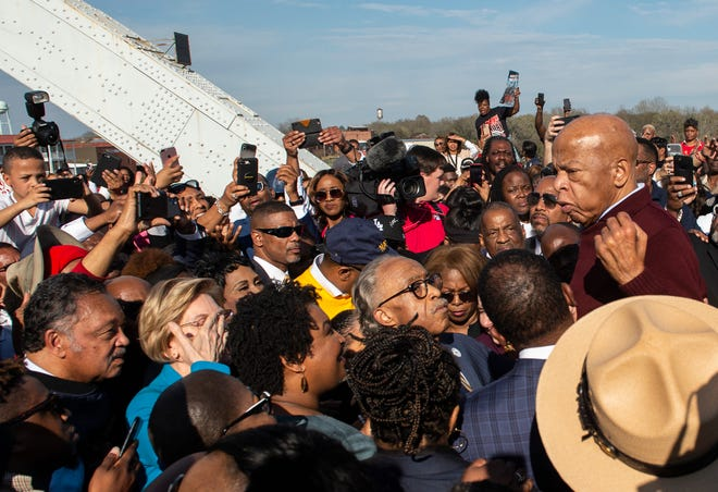 U.S. Rep. John Lewis speaks on the Edmund Pettus Bridge in Selma, Ala., on Sunday, March 1, 2020.