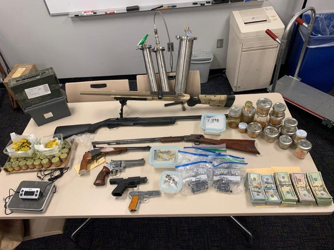 Evidence seized during a search warrant of a marijuana butane honey oil lab in Lockwood Valley on Thursday, including  firearms, vape cartridges and over $40,000 in cash.