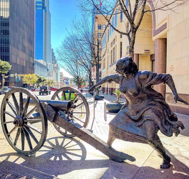 The Angelina Eberly statue on Congress Avenue recreates a scene from the Archives War of 1842.
