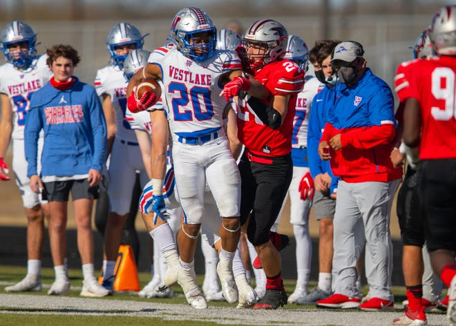 Westlake running back Zane Minors is shoved out of bounds by San Antonio Stevens defensive back Jaiden Lopez during Westlake's 71-14 win in a 6A Division I regional semi-final playoff Saturday at Bastrop ISD Memorial Stadium. Minors finished with 154 yards from scrimmage and two touchdowns.