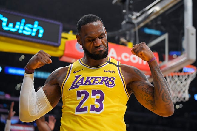 FILE - In this Jan. 7, 2020, file photo, Los Angeles Lakers forward LeBron James gestures after scoring and drawing a foul during the first half of an NBA basketball game against the New York Knicks in Los Angeles.  James was announced Saturday, Dec. 26,  as the winner of The Associated Press' Male Athlete of the Year award for a record-tying fourth time.(AP Photo/Mark J. Terrill, File)