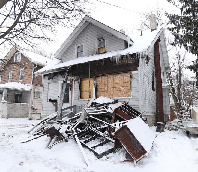 The aftermath of a Christmas night house fire that displaced a family at 864 Sheridan St. in Akron on Saturday.