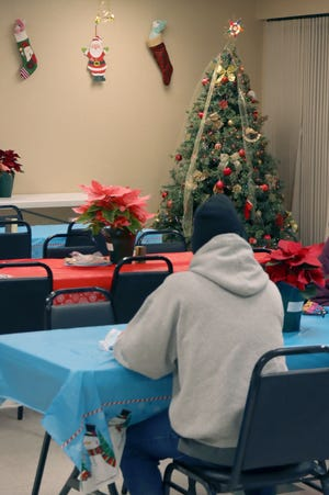 With social distancing in place, the Salvation Army hosted its annual Christmas Dinner for those in need in Amarillo. [Neil Starkey / For the Amarillo Globe-News]