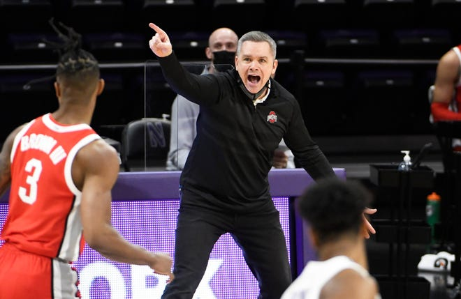 Ohio State coach Chris Holtmann gestures to his team during the first half of the game at Northwestern.
