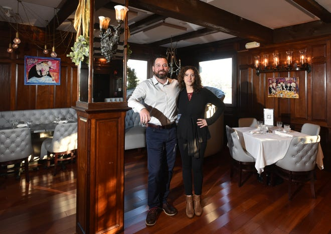 "Jen Villa and Blane Toedt, owners of The West End restaurant in Hyannis. Due to the pandemic, ""We're doing three times the work for a third of the income,"" said Toedt. Restaurant owners statewide say sales are down 43% this year, according to a survey."
