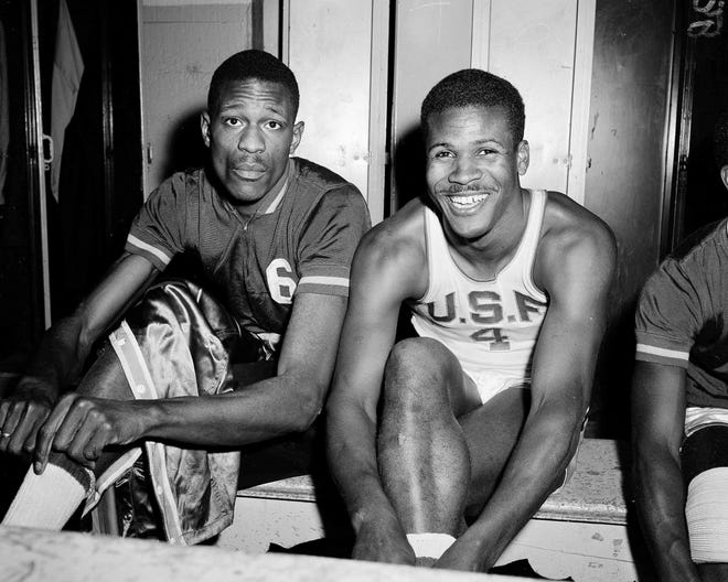 K.C. Jones, captain of the University of San Francisco Dons, right, is shown with teammate Bill Russell in March 1956. Basketball Hall of Famer Jones, an Olympic gold medalist and two-time NCAA champion who won eight straight NBA titles during the Celtics' Russell era and then coached the Boston teams with Larry Bird, Kevin McHale and Robert Parish to two more championships in the 1980s, has died. He was 88.