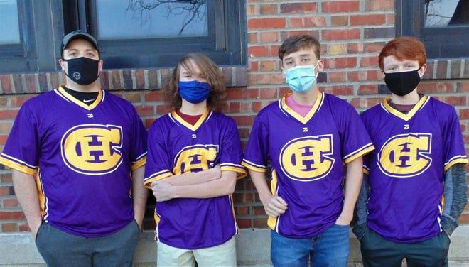 Hickman High School's state champion Rocket League team from left, Coach Matthew Pryor, and team members Owen Keeler, Jack Hamilton and Caleb Kincheloe.