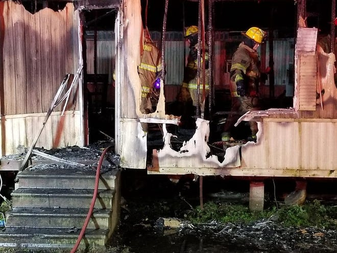 St. John volunteer firefighters work the scene of a blaze Christmas evening on Anthony Drive near Thibodaux.