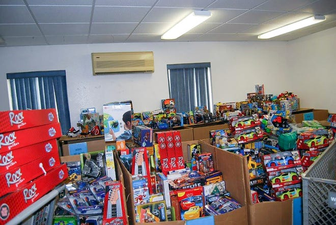 Toys are separated by gender and age into boxes to fulfill applications  at the Toys for Tots warehouse in Fruitland Park. [Submitted]