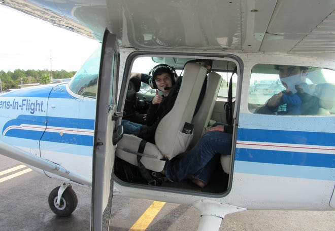 Terminally ill, 14-year old Austin Booth gets the chance of a lifetime to co-pilot the newly donated Cessna 172 from the Heiser Foundation, courtesy of Teens-In-Flight, on Saturday, Dec. 19, at the Flagler Executive Airport.