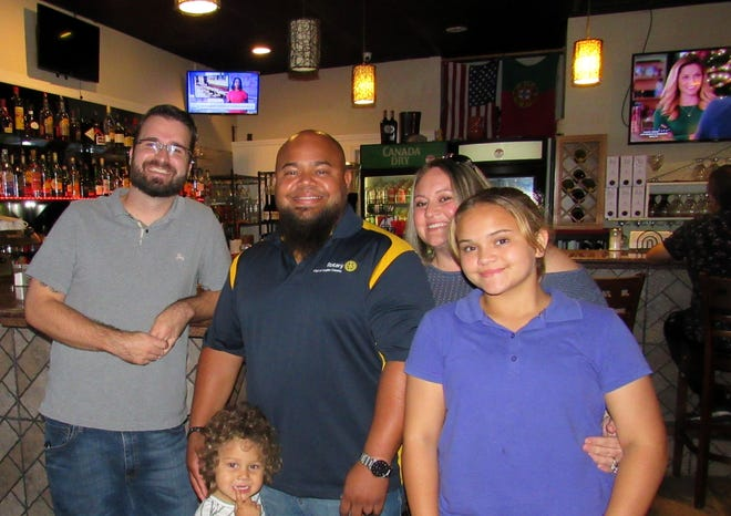 Portugal Wine Bar & Grlll co-owner Jeremy Pombier greets Charles Barbel and family for dinner. Barbel chairs the 2020 Taste of the Holidays campaign, launched in conjunction with the Rotary Club of Flagler County's 15th Annual Fantasy Lights, for December. From left: Jeremy Pombier, Charles Barbel, Corbyn Barbel, Sarah Barbel and Makayla Barbel.