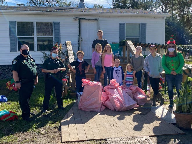 PAL drop Christmas 2020: Members of the Flagler County Sheriff's Office and Police Athletic League delivered gifts to families this holiday.