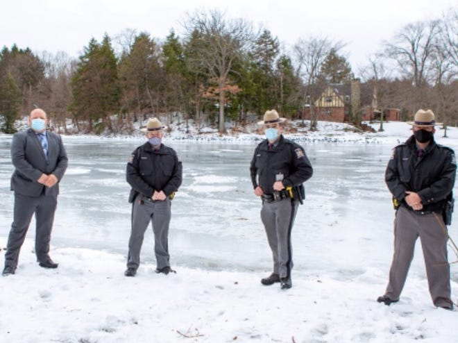 Wayland-based State Police Inv. Jeremy Hagadone and troopers Matt McKinney, Rocky Cerretto, and Jason Allison saved a man who had fallen through the ice at Loon Lake Dec. 23, 2020.