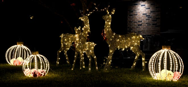 Large lighted Christmas ornaments and deer decorate a residence's yard in the 2100 block of Sunflower Street to celebrate the holiday season. [BRAD NADING/GARDN CITY TELEGRAM]