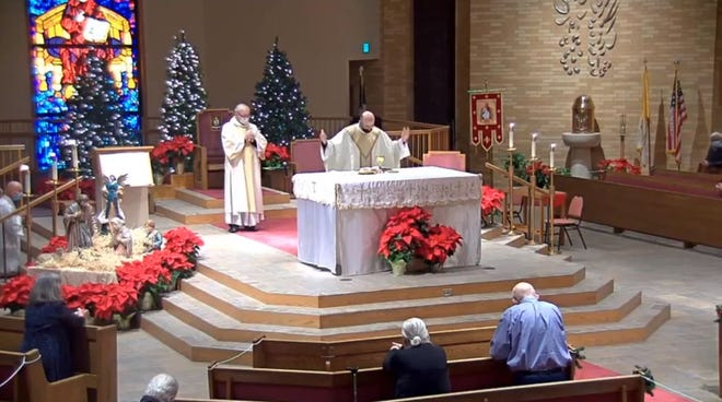An image from Christ the King Cathedral's 8 p.m. Christmas Eve Mass on Thursday with Friar Wesley Beal.
