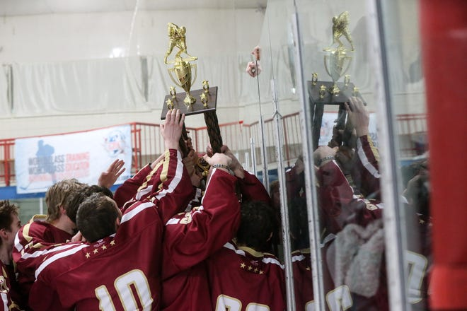 Algonquin hoists the championship trophy after winning the championship game of the 2018 Daily News Cup over Hopkinton at the New England Sports Center in Marlborough.