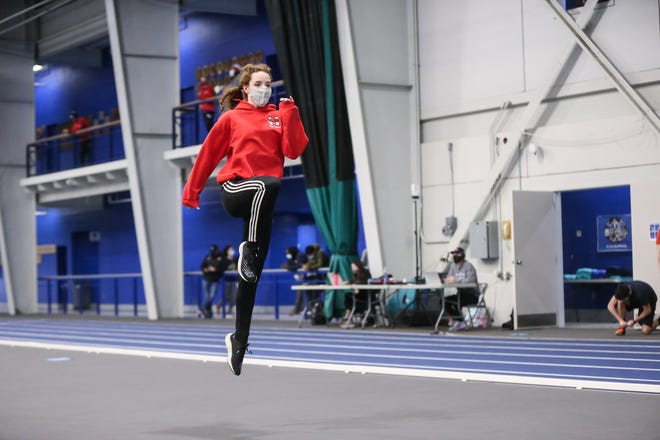 Milford High senior Kerry O'Connor warms up during the MSTCA and Bay State Running invitationals at Wheaton College in Norton on Dec. 19, 2020.