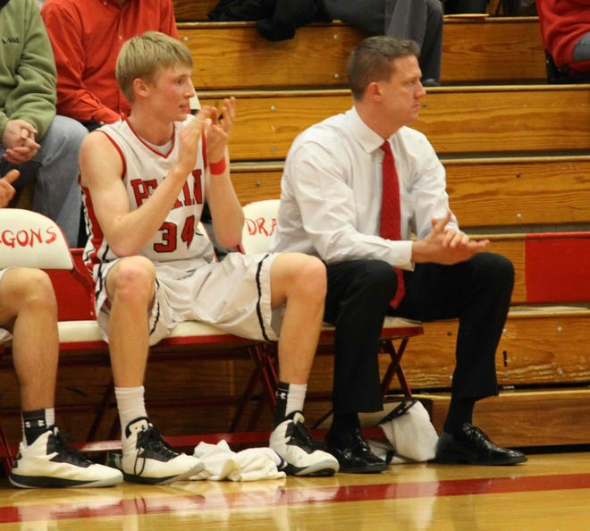 Pat Taphorn sits next to his son Nathan Taphorn during a Pekin boys basketball game in 2012.