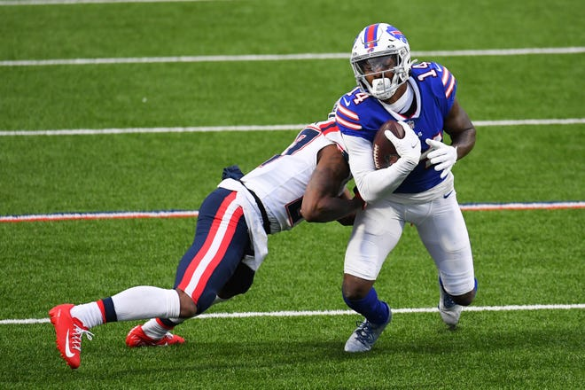 Patriots cornerback J.C. Jackson tackles Bills wide receiver Stefon Diggs after a catch during their game on Nov. 1. The two are expected to go against each other again on Monday night.