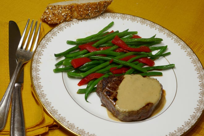 Beef tenderloin in cognac sauce with French green beans.