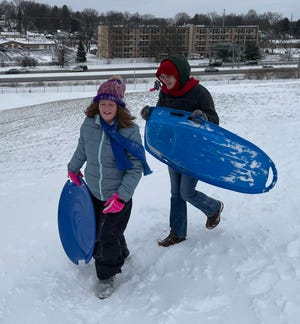 Samantha Luck and her mom, Wendy, at the Malone University sled hill.