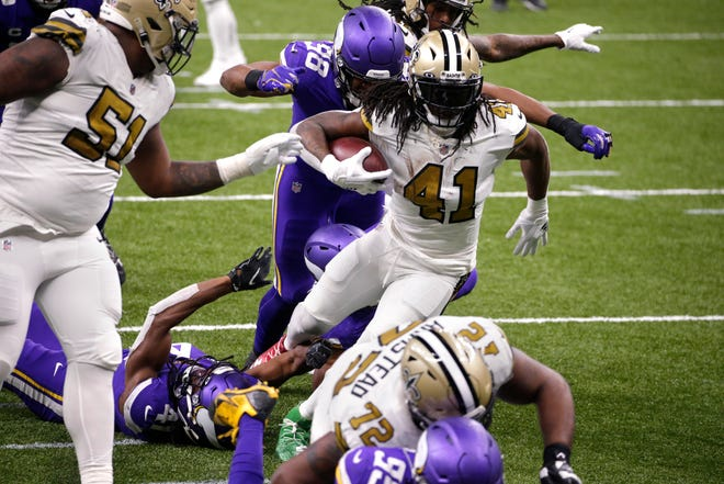New Orleans running back Alvin Kamara rushes for his fifth touchdown of Friday's game.