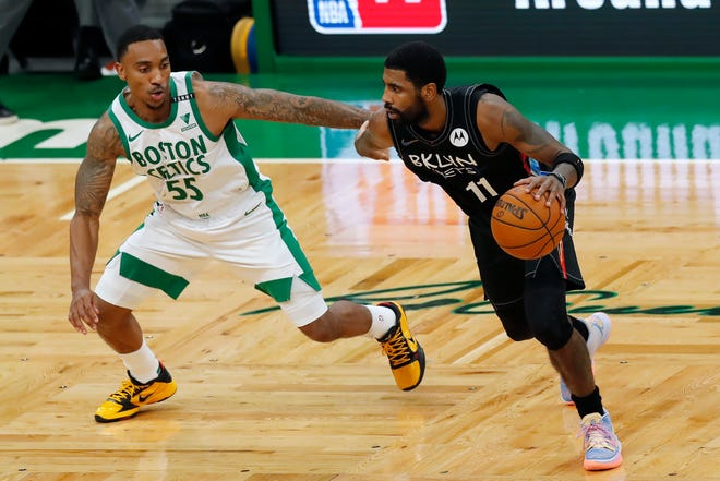 Brooklyn's Kyrie Irving drives past Boston's Jeff Teague during Friday's game.