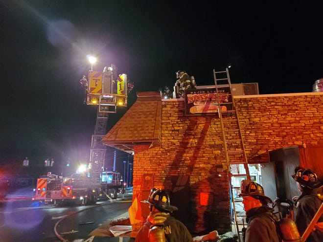 Firefighters at the scene of a fire on Christmas night at Major League Roast Beef & Wings in Auburn. Damage from the electrical fire was confined to the roof. The Washington Street restaurant reopened on Saturday. [Auburn Fire Department]
