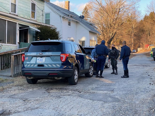 State police gather at the scene of a reported armed home invasion in the Gilbertville section of Hardwick on Saturday afternoon. State police are assisting Hardwick-New Braintree Police in their investigation.