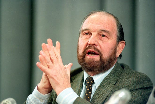 In this 1992 file photo, George Blake, a former British spy who doubled as a Soviet agent, gestures during a news conference in Moscow.