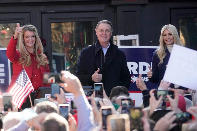 Sen. Kelly Loeffler, R-Ga., left, stands with Sen. David Perdue, R-Ga., and Ivanka Trump, Assistant to the President, during a campaign rally, Monday in Milton, Ga.