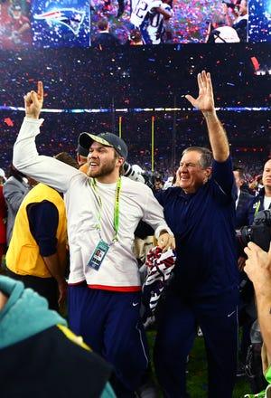 Patriots coach Bill Belichick, right, celebrates with son Brian Belichick after New England's win over Atlanta in Super Bowl LI.