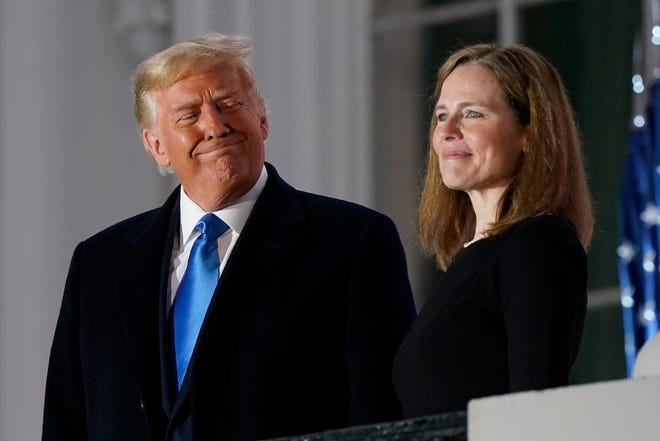 In this Oct. 26 photo, President Donald Trump and Amy Coney Barrett stand on the Blue Room Balcony after Supreme Court Justice Clarence Thomas administered the Constitutional Oath to her on the South Lawn of the White House White House in Washington.