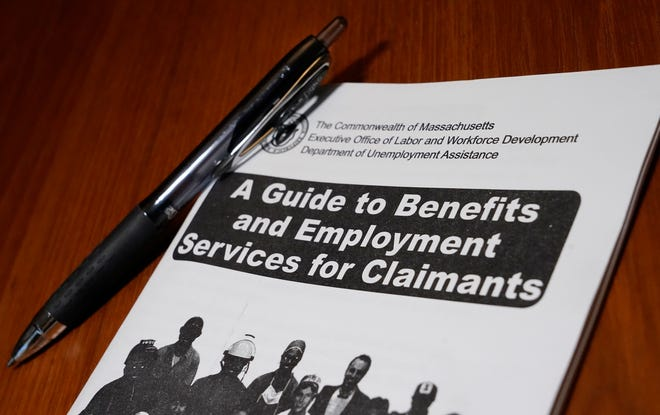 In this Nov. 5 file photo, a booklet describing unemployment benefits is seen on a desk in North Andover.