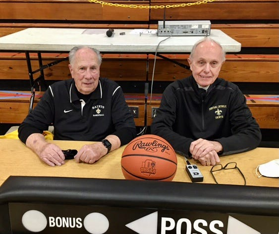 Tom Bearducci (left) and Ed Young have over 100 years of combined experience at the scorer's table.