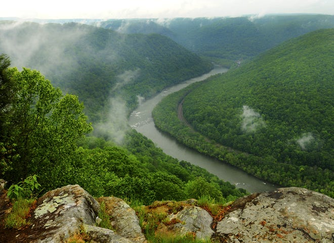 This May 9, 2012, photo shows the Grandview State Park overlooking the New River Gorge National River in Grandview, W.Va.  The story of protecting New River's natural state — and the making of a world of consequences — depended on 14 years of court battles, politics and luck.  (AP Photo/The Charleston Gazette, Kenny Kemp)