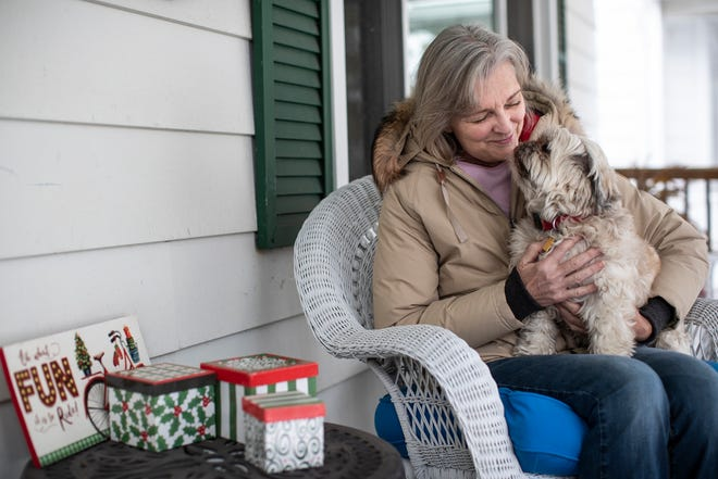 Kelli Ketzler of Grosse Pointe Parks kisses her dog Charlie, an 8-year-old Shih Tzu, at her home on Saturday, Dec. 26, 2020.
