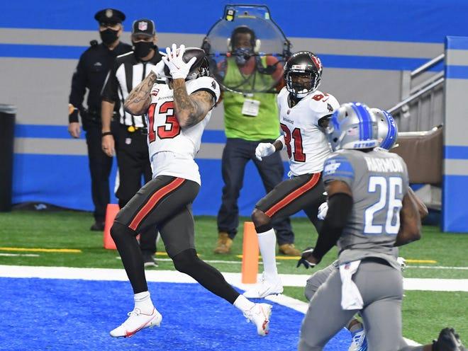 Mike Evans dari Tampa Bay melakukan touchdown di kuarter pertama.