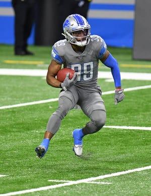 Detroit Lions'Jamal Agnew kembali melakukan tendangan pada babak kedua.