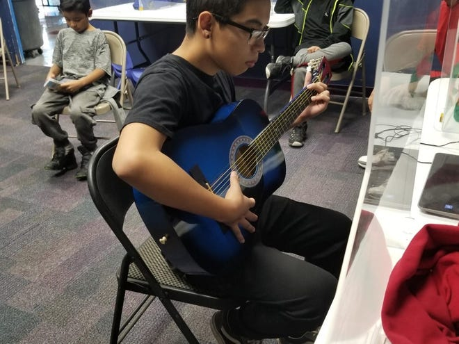 City of Las Cruces Weed and Seed participants share the gift of music this holiday season after an anonymous gift of twelve guitar starter packages were delivered this week.