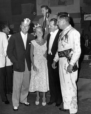 Jack Wrather, left, and his wife, Bonita Granville Wrather, with Ray Ryan at far right. Ryan was an owner of the El Mirador Hotel after the government used it as an Italian POW camp during World War II.