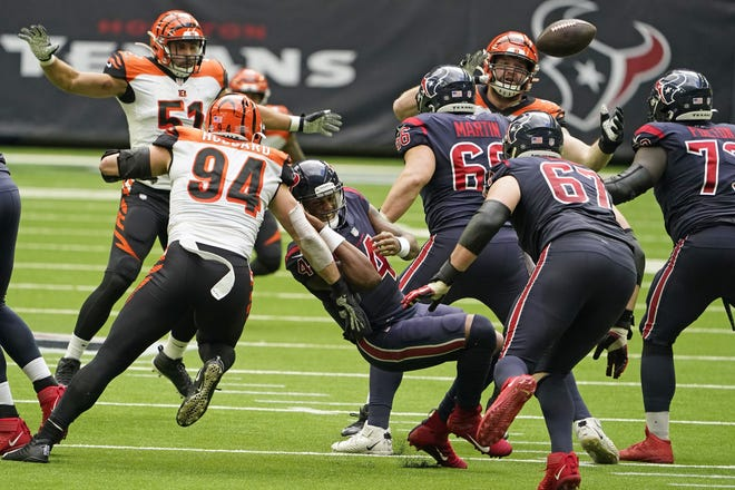 Houston Texans quarterback Deshaun Watson fumbles the football as he is hit by Cincinnati Bengals' Sam Hubbard during a fourth quarter drive of their 37-31 loss Sunday.